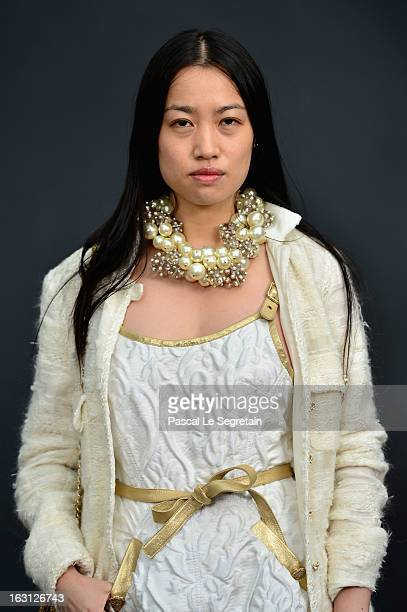 Yi Zhou attends the Chanel Fall/Winter 2013 ReadytoWear show as part of Paris Fashion Week at Grand Palais on March 5 2013 in Paris France
