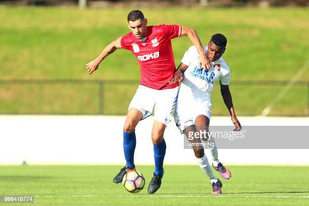 Yianni Fragogiannis of United 58 and Hassan Jalloh of the White Eagles challenge for the ball during the Men's NSW NPL match between Sydney United 58...