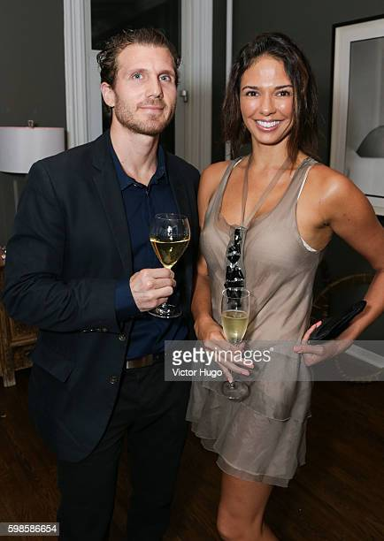 Yianni Ligas and Ana Lucia Souza attend the Cube Art Fair Intimate New York Party on September 1 2016 in New York City