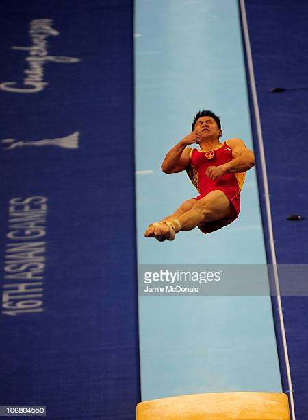 Yibing Chen competes in the vault during the Artistic Gymnastics Men's Qualification and Team Final the at the Asian Games Town Gymnasium during day...