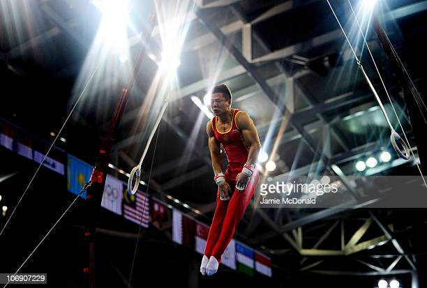 Yibing Chen of China competes in The Rings at the Men's Apparatus Artistic Gymnastics Final at the Asian Games Town Gymnasium during day four of the...