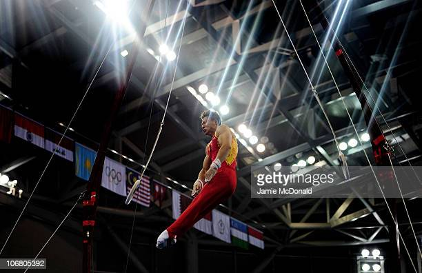 Yibing Chen of China competes in The Rings during th Artistic Gymnastics Men's Qualification and Team Final the at the Asian Games Town Gymnasium...