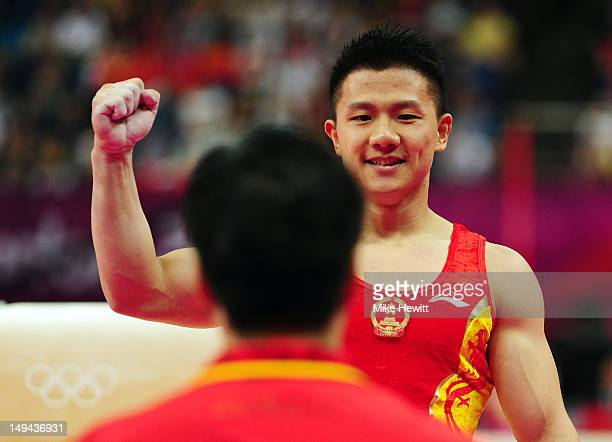 Yibing Chen of China reacts after he competes in the pommel horse in the Artistic Gymnastics Men's Team qualification on Day 1 of the London 2012...