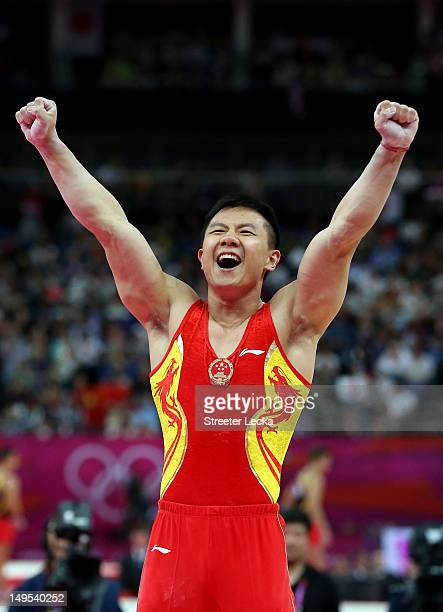 Yibing Chen of China reacts after the pommel horse in the Artistic Gymnastics Men's Team final on Day 3 of the London 2012 Olympic Games at North...
