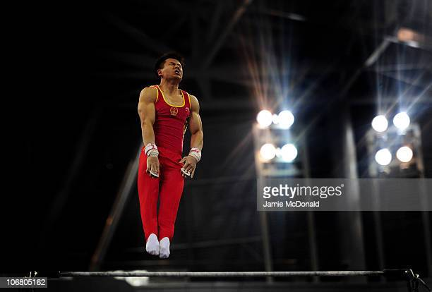 Yibing Chenof China competes in High Bar in the Artistic Gymnastics Men's Qualification and Team Final the at the Asian Games Town Gymnasium during...