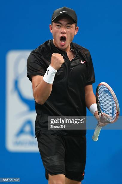 Yibing Wu of China celebrates a point during the match against Thiago Monteiro of Brazil during Day 1 of 2017 ATP Chengdu Open at Sichuan...