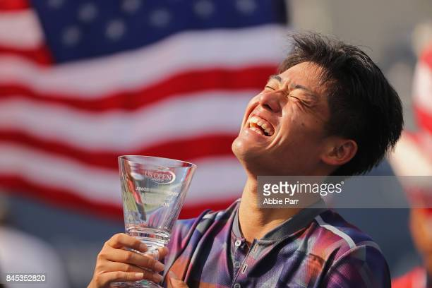 Yibing Wu of China holds the championship trophy after defeating Axel Geller of Argentina in their Junior Boys' Singles finals match on Day Fourteen...