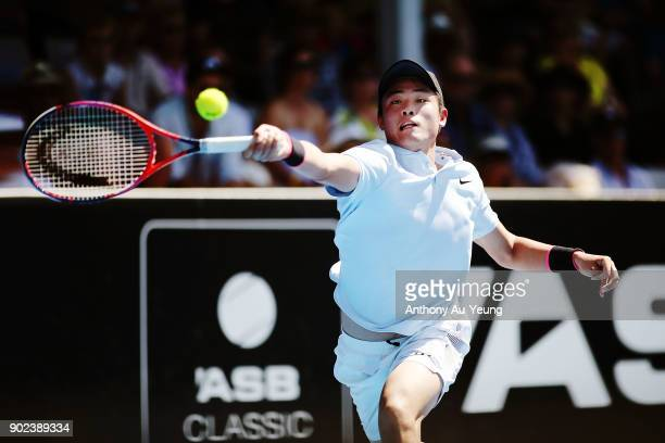 Yibing Wu of China plays a forehand in his first round match against David Ferrer of Spain during day one of the ASB Men's Classic at ASB Tennis...