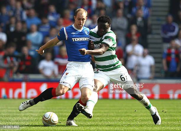 Yictor Wanyama of Celtic tries to tackle Steven Whittaker of Rangers during the Clydesdale Bank Scottish Premier League match between Rangers and...