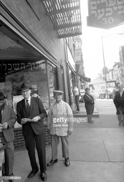 Yiddish writer and journalist for The Jewish Daily Forward Isaac Bashevis Singer poses for a portrait outside the Forward Building on the Lower East...