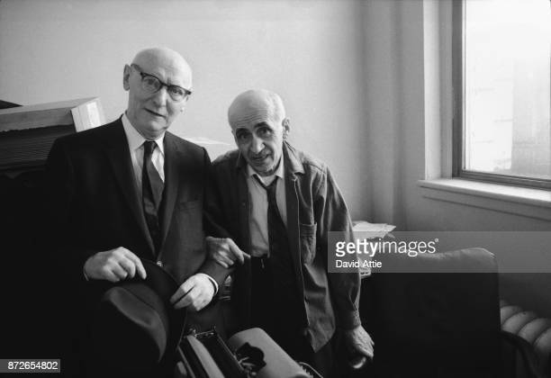 Yiddish writer and journalist for The Jewish Daily Forward Isaac Bashevis Singer poses for a portrait with coworker and poet Maurice Winograd in the...