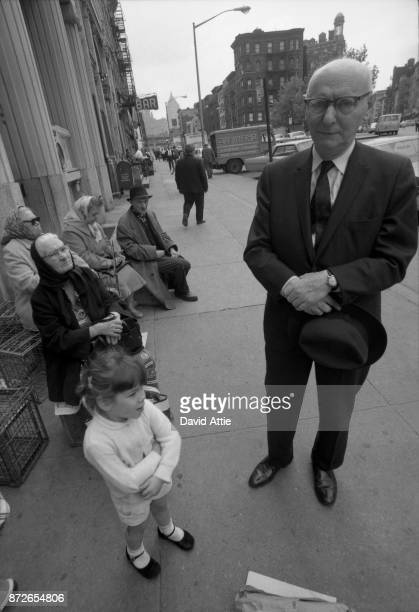 Yiddish writer and journalist for The Jewish Daily Forward Isaac Bashevis Singer poses for a portrait on East Broadway near the Forward Building in...