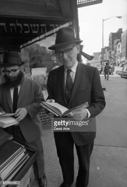Yiddish writer and journalist for The Jewish Daily Forward Isaac Bashevis Singer poses for a portrait outside the S Rabinowitz Hebrew Book Store at...