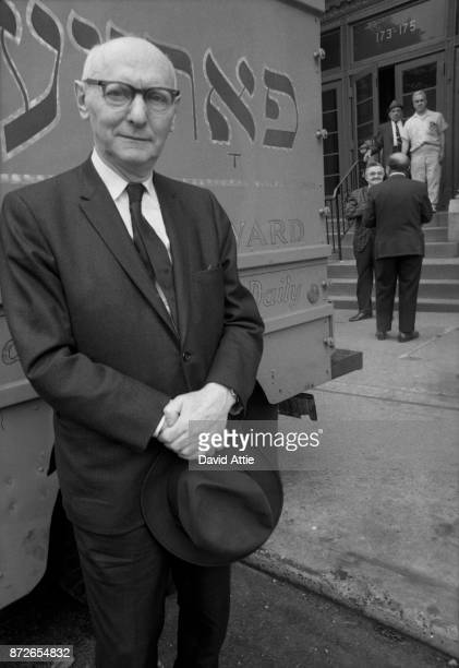 Yiddish writer and journalist for The Jewish Daily Forward Isaac Bashevis Singer poses for a portrait outside the Forward Building in the Lower east...