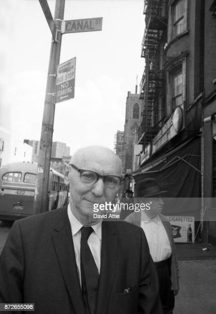 Yiddish writer and journalist for The Jewish Daily Forward Isaac Bashevis Singer poses for a portrait at the intersection of Canal and Rutgers...