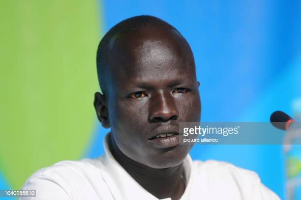 Yiech Pur Biel from South Sudan of the Olympic Refugee Team for Athletics, attends a news conference at the Main Press Centre at Olympic Parc Barra...