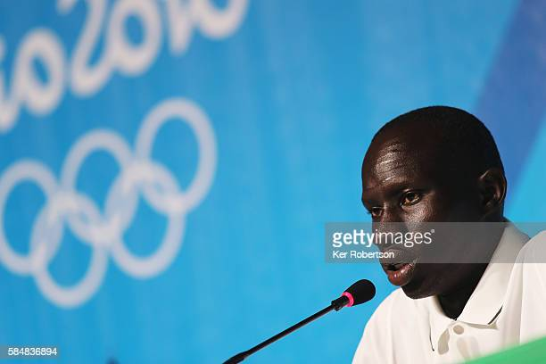 Yiech Pur Biel of the Olympic Refugee Team talks while attending a press conference given by the Olympic Refugee Team on July 31, 2016 in Rio de...