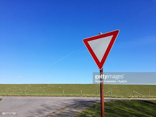 Yield Road Sign Against Clear Blue Sky