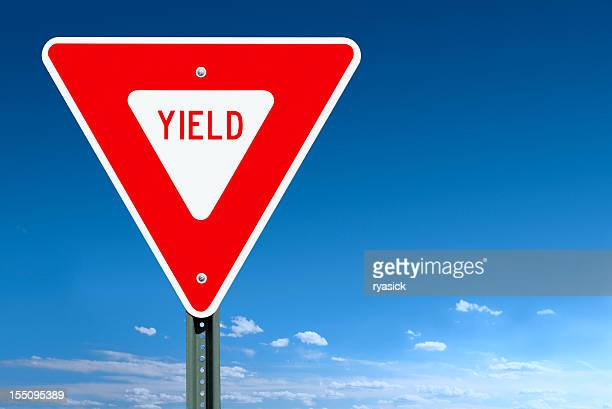yield road sign post over a blue sky - give way stock pictures, royalty-free photos & images