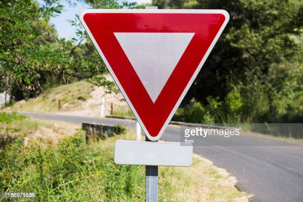yield sign with road - give way stock pictures, royalty-free photos & images