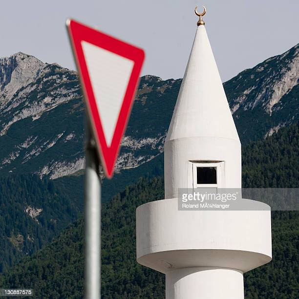 Yield-sign with minaret, controversial mosque in Telfs, Tyrol, Austria, Europe
