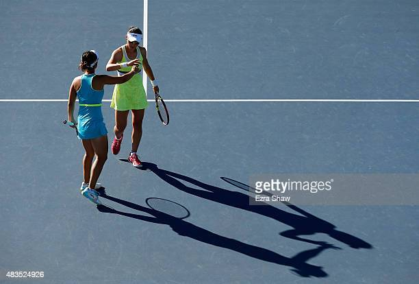 YiFan Xu and Saisai Zheng of China high five one another during their match against Anabel Medina Garrigues and Arantxa Parra Santonja of Spain in...