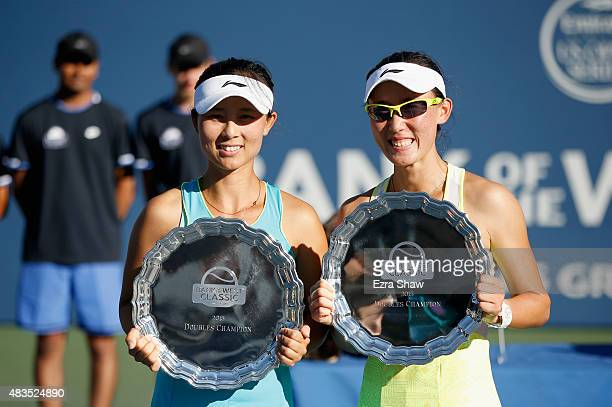 YiFan Xu and Saisai Zheng of China hold up their trophies after they beat Anabel Medina Garrigues and Arantxa Parra Santonja of Spain in the doubles...