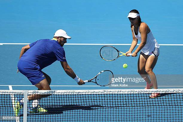 Yifan Xu of China and Fabrice Martin of France compete against Liezel Huber of the United States and Marcin Matkowski of Poland in their first round...
