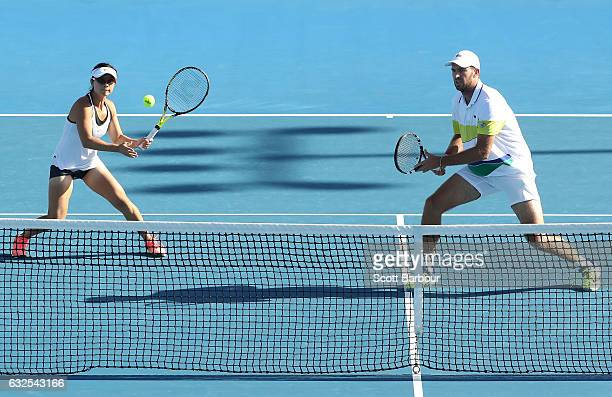 Yifan Xu of China and Fabrice Martin of France compete in their second round match against Bethanie Mattek-Sands and Mike Bryan of the United States...