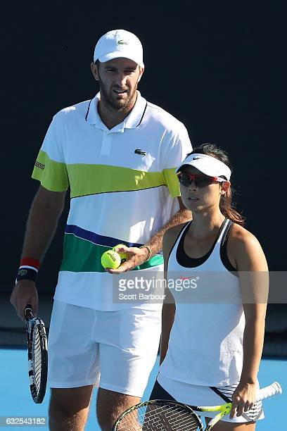Yifan Xu of China and Fabrice Martin of France compete in their second round match against Bethanie MattekSands and Mike Bryan of the United States...