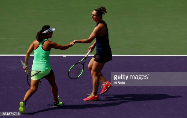 Yifan Xu of China and Gabriela Dabrowski of Canada celebrate a point against Andrea Hlavackova of the Czech Republic and Shuai Peng of China during...