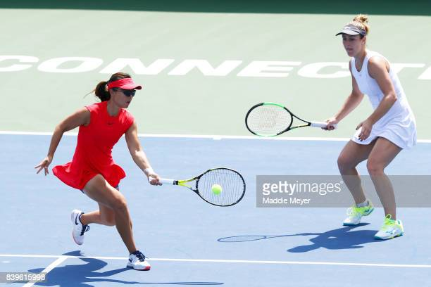 Yifan Xu of China and Gabriela Dabrowski of Canada compete against Ashleigh Barty and Casey Dellacqua of Australia during Day 9 of the Connecticut...
