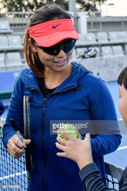 Yifan Xu of China, partner of Gabriela Dabrowski of Canada, signs an autograph during the Inclub Clinic on day six of the 2017 China Open at the...