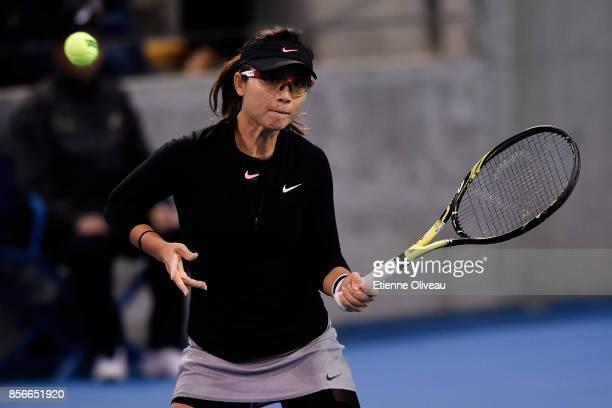 Yifan Xu of China returns a shot in a match in partnership with Gabriela Dabrowski of Canada against Nadiia Kichenok of Ukraine and Anastasia...