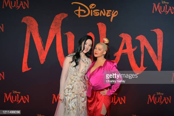 Yifei Liu and Christina Aguilera attend the World Premiere of Disney's 'MULAN' at the Dolby Theatre on March 09 2020 in Hollywood California