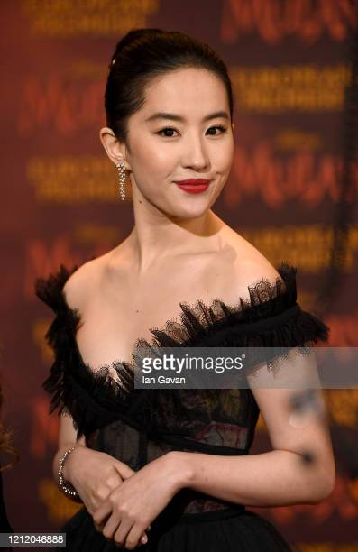 "Yifei Liu attends the European Premiere of Disney's ""MULAN"" at Odeon Luxe Leicester Square on March 12, 2020 in London, England."