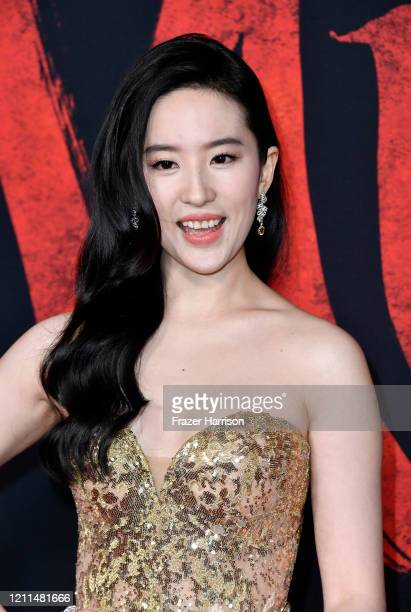 Yifei Liu attends the Premiere Of Disney's Mulan on March 09 2020 in Los Angeles California