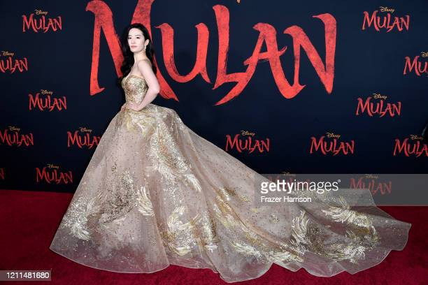 """Yifei Liu attends the Premiere Of Disney's """"Mulan"""" on March 09, 2020 in Los Angeles, California."""