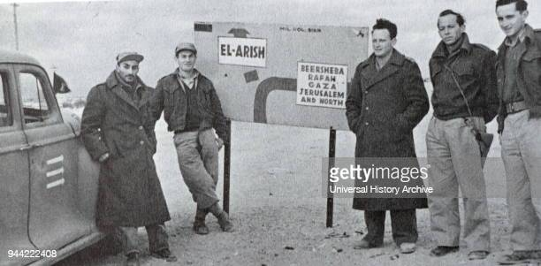 Yigal Allon in a group of Israeli soldiers in Northern Negev during the Israeli War of Independence 1948 Yigal Allon was an Israeli politician a...