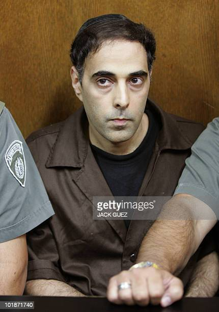 Yigal Amir, the convicted assassin of late Israeli Prime Minister Yitzhak Rabin, sits during a court hearing in Tel Aviv 01 November 2007. The...