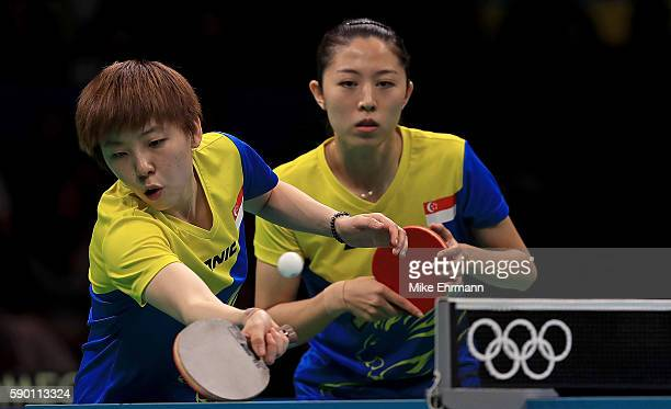 Yihan Zhou and Mengyu Yu of Singapore play a doubles match against Mima Ito and Ai Fukuhara of Japan during the Womens Team Bronze Medal match on Day...