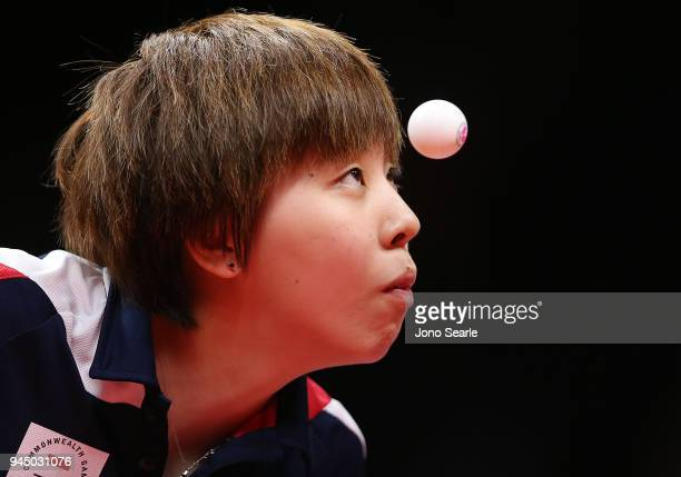 Yihan Zhou of Singapore competes in the women's doubles match with team mate Ye Lin against Miao Miao and Jian Fang Lay of Australia during Table...