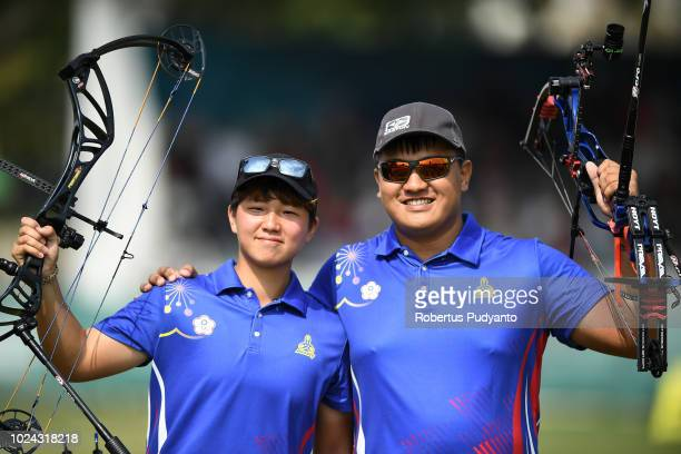 Yihsuan Chen and Yuping Pan of Chinese Taipei celebrate their gold medals during Compound Mixed Team Archery Final Rounds on day nine of the Asian...
