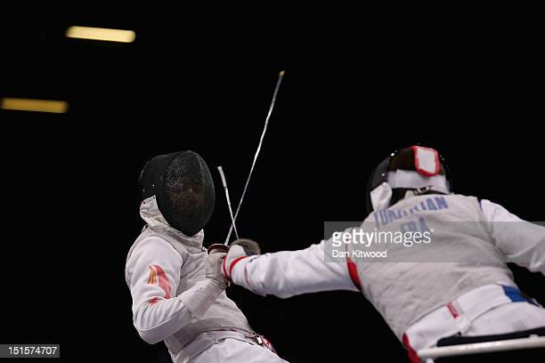 Yijun Chen competes against Damien Tokatlian of France during the Men's Team Catagory Open Wheelchair Fencing Final on day 10 of the London 2012...