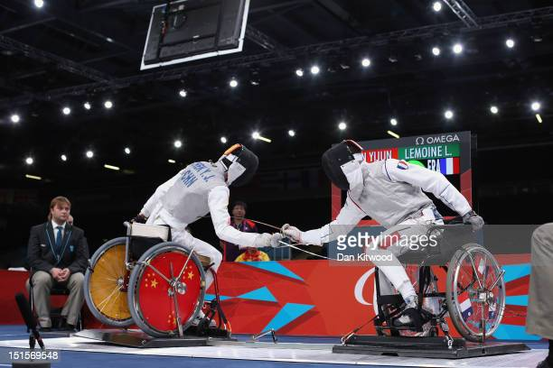 Yijun Chen competes against Ludovic Lemoine of France during the Men's Team Catagory Open Wheelchair Fencing Final on day 10 of the London 2012...