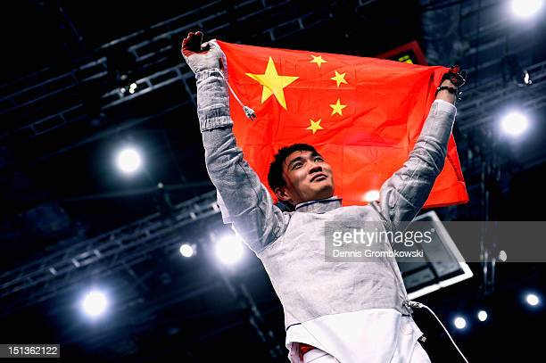 Yijun Chen of China celebrates after winning the gold in Men's Individual Sabre Wheelchair Fencing Category A on day 8 of the London 2012 Paralympic...