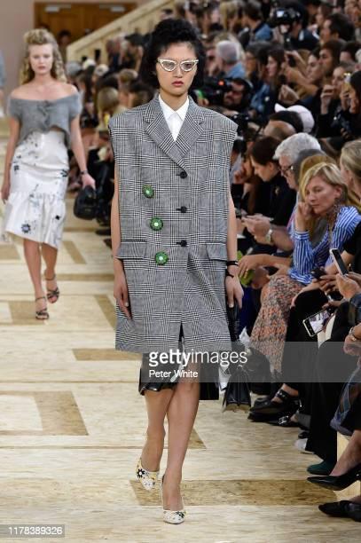 Yilan Hua walks the runway during the Miu Miu Womenswear Spring/Summer 2020 show as part of Paris Fashion Week on October 01, 2019 in Paris, France.