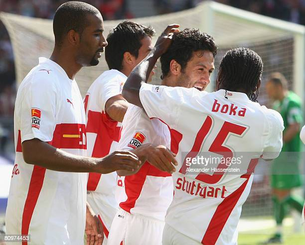 Yildiray Bastuerk of Stuttgart celebrates scoring the 3rd goal with his team mates Arthur Boka and Cacau during the Bundesliga match between VfB...