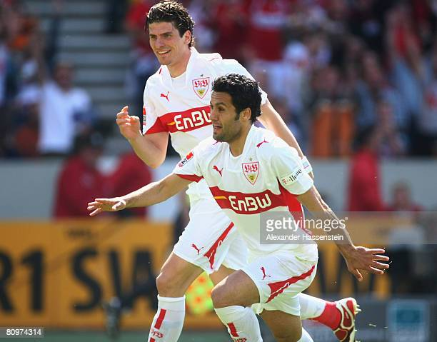 Yildiray Bastuerk of Stuttgart celebrates scoring the first goal with his team mate Mario Gomez during the Bundesliga match between VfB Stuttgart and...