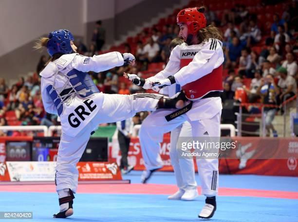 Yildiz Bekir of Turkey competes against Maria Fouledaki of Greece during Women's Taekwondo 67kg bronze medal match match within the 23rd Summer...